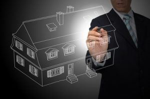 Business Man Drawing house or estate as real estate concept